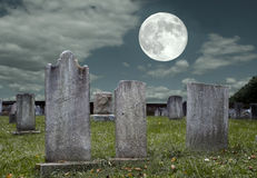 Graveyard at Full Moon. An old graveyard in the light of the full moon Royalty Free Stock Images