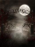 Graveyard gate. Night scenery with a graveyard gate and thorns Royalty Free Stock Photo