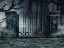 Graveyard gate with trees. Gothic graveyard gate with old withered trees Stock Image