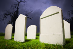 Graveyard at Halloween night Stock Photo