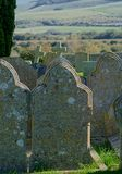 Graveyard Headstones with a view. Church graveyard with headstones facing toward a fine view of the countryside. A peaceful spiritual resting place royalty free stock image