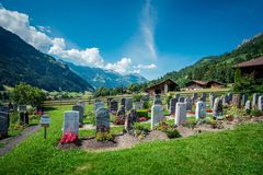 Graveyard among the natural view and beautiful alpine. Scenery royalty free stock photo