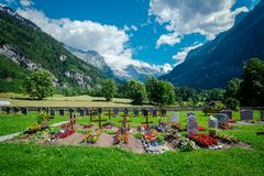 Graveyard among the natural view and beautiful alpine. Scenery royalty free stock photography