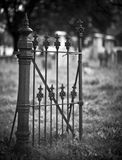 Graveyard. Old entrance gate and graves in an ancient church graveyard Stock Images