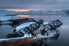 Graveyard of old ships on the shore the frozen Barents Sea Stock Photography