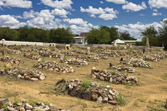 Graveyard with rocks on graves Royalty Free Stock Photography