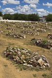 Graveyard with rocks on graves Stock Image