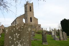 Graveyard at Ruined Church Building in Bankfoot, Perthshire. A view across an old graveyard toward a ruined church building in the village of Bankfoot in Stock Photography