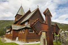 Graveyard rusted catholic cross. Norwegian stave church. Roldal Royalty Free Stock Photos