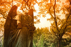 Graveyard scene: headless statue among autumn trees Stock Photography