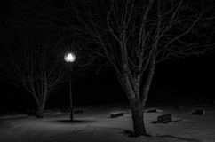 Graveyard. A snowy graveyard at night Royalty Free Stock Images