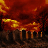Graveyard. Spooky graveyard with burning sky Stock Image