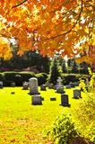 Graveyard with tombstones Stock Images