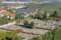 Graveyard in Trentino-Alto Adige, Italy. Friedhof (cemetery, graveyard) surrounded by Apple Orchard in Trentino-Alto Adige, Italy stock photography