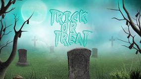 Graveyard Trick or Treat in the Fog. This video features a camera panning out to reveal a foggy cemetery graveyard with an animated trick or treat message stock video