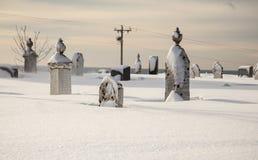 Graveyard in winter Royalty Free Stock Photos
