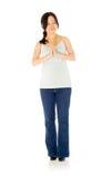 Gravid asiatisk kvinna som isoleras på vit preying Royaltyfria Bilder