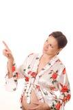 Gravid kvinna visar upp fingret Royaltyfri Foto