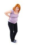 Gravid kvinnabaksida smärtar Arkivbild