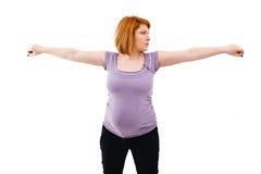 Gravid kvinnasträckning Arkivfoto
