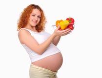 Gravid mom för ung redhead Fotografering för Bildbyråer