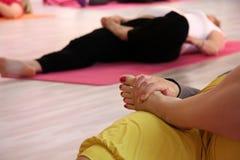 Gravid yoga. Gravid women doing yoga in yoga studio stock images