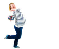Gravida kvinnan som förväntar, kopplar samman att le, och rymma behandla som ett barn par av Arkivbilder