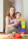 Gravida moderspelrum med barnet Royaltyfri Bild