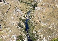 The Gravina di Matera, a river carving the ravine on which Matera was built. Pictured is the Gravina di Matera, a river carving the ravine on which the city of Royalty Free Stock Images