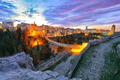 Gravina in Puglia ancient town, bridge and canyon at sunrise. Panoramic view of old city Gravina in Puglia, Apulia, Italy. Europe stock photography