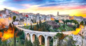 Gravina in Puglia ancient town, bridge and canyon at sunrise. Panoramic view of old city Gravina in Puglia, Apulia, Italy. Europe stock photo