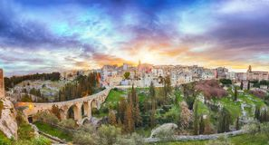 Gravina in Puglia ancient town, bridge and canyon at sunrise. Panoramic view of old city Gravina in Puglia, Apulia, Italy. Europe royalty free stock image