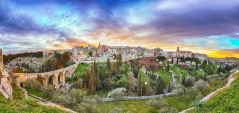 Gravina in Puglia ancient town, bridge and canyon at sunrise. Panoramic view of old city Gravina in Puglia, Apulia, Italy. Europe stock images