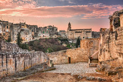 Gravina in Puglia, Bari, Italy: landscape at sunrise of the old. Town with the cathedral seen from the pathway with the source at the entrance of the ancient Stock Photography