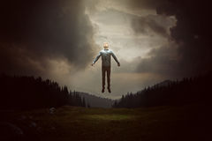 Gravity. Man is picked up by alien Stock Photo