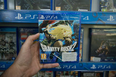 Gravity Rush 2. Bratislava, Slovakia, circa april 2017: Man holding Gravity Rush 2 videogame on Sony Playstation 4 console in store Royalty Free Stock Photography