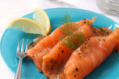 Gravlax Slices. Slices of cured gravlax on a blue dish Stock Images