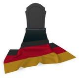 Gravsten och flagga av Tyskland Arkivfoto