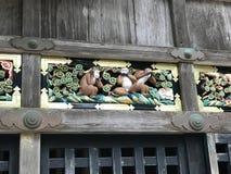 Gravure van de drie wijze apen bij het Heiligdom van Nikko Toshogu Stock Afbeeldingen