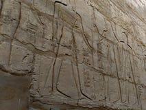 Gravures op de muur van de oude tempel van Egypte Stock Foto