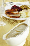 Gravy Boat and Dinner Royalty Free Stock Photography