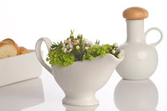 Gravy boat flower decorated Stock Photo