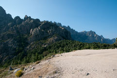 Grawel path in mountains of Corsica Royalty Free Stock Images