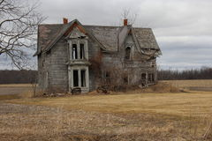 Gray abandon Home. Old rural wooden home abandon royalty free stock photo
