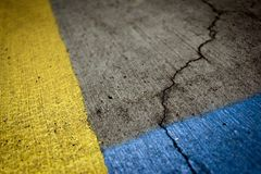 Gray Asphalt Road With Blue and Yellow Paint Royalty Free Stock Photos