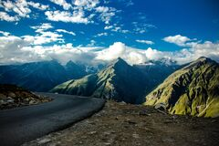 Gray Asphalt Road Near Green Fold Mountain at Daytime Royalty Free Stock Photography