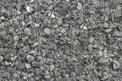 Gray asphalt texture. With gravel stones Royalty Free Stock Images