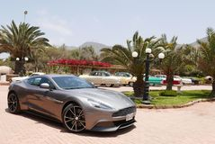 Gray Aston Martin Vanquish coupe in Lima. Lima, Peru. November 11, 2017. Front and side view of a mint condition gray Aston Martin Vanquish coupe at south of Stock Photos