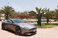 Gray Aston Martin Vanquish coupe at south of Lima. Lima, Peru. November 11, 2017. Front and side view of a mint condition gray Aston Martin Vanquish coupe at Royalty Free Stock Photos