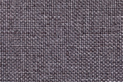 Gray background with braided checkered pattern, closeup. Texture of the weaving fabric, macro. stock photos
